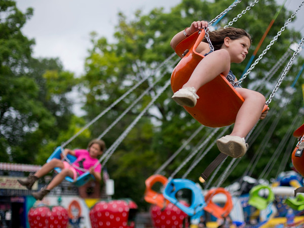 JAY YOUNG | THE GOSHEN NEWS<br /> Eight-year-old Laynee Caldwell, of Kendallville, hangs on as she spins around and around while riding the spinning swings at the Noble County Fair Tuesday afternoon in Kendallville. The fair continues through Saturday.