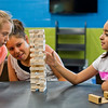 JAY YOUNG | THE GOSHEN NEWS<br /> Ella McHugh, 9, left, and Rosie Herrera, 10, center, watch as Arianna Olvera, 8, carefully slides a Jenga block out without making the whole game tumble down at the Goshen Boys & Girls Club Monday afternoon. The club opened Monday after a massive renovation project that added 20,000 square feet to the building. It was closed since June 2016.