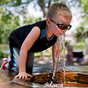 JAY YOUNG | THE GOSHEN NEWS<br /> Four-year-old Michael Pittman, of Elkhart, cools off with a drink from a water fountain during the Rhapsody in Green Music Festival at Island and Bicentennial Parks in Elkhart.