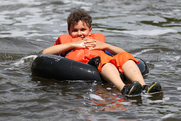 JAY YOUNG | THE GOSHEN NEWS<br /> Ten-year-old Trenton Bias, of Elkhart, leans back as he enjoys the ride down the Elkhart River during the Rhapsody in Green Music Festival at Island and Bicentennial Parks in Elkhart.