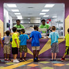 JAY YOUNG | THE GOSHEN NEWS<br /> A group of boys wait in line as Alicia Malone, left, and Dajah Frye serve lunch at the Goshen Boys & Girls Club Monday afternoon. The club opened Monday after a massive renovation project that added 20,000 square feet to the building. It was closed since June 2016.