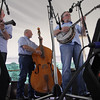 GEOFF LESAR | THE GOSHEN NEWS<br /> <br /> From left, Joe Mitchell Sr., Vern Brink and Dennis Mitchell of Ottawa County Bluegrass Band, of Port Clinton, Ohio, perform a set Saturday afternoon during the 13th annual Wakarusa Bluegrass Festival.
