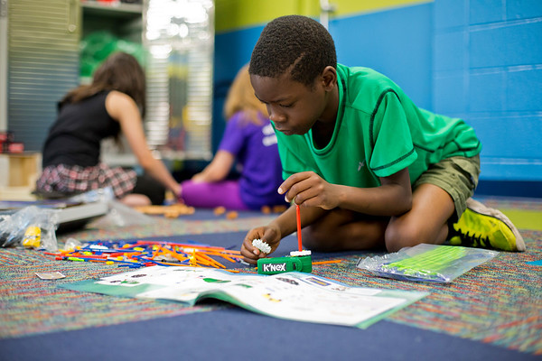 JAY YOUNG | THE GOSHEN NEWS<br /> Ten-year-old Douglas Subili, of Goshen, builds a rollercoaster out of a K'nex set at the Goshen Boys & Girls Club Monday afternoon. The club opened Monday after a massive renovation project that added 20,000 square feet to the building. It was closed since June 2016.