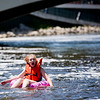 JAY YOUNG | THE GOSHEN NEWS<br /> Francesca Carlen, of Elkhart, lets out a small scream as she gets turned around while floating down the Elkhart River during the Rhapsody in Green Music Festival at Island and Bicentennial Parks in Elkhart.