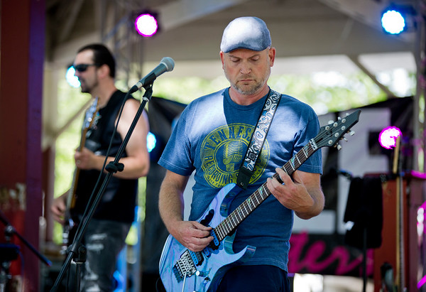 JAY YOUNG   THE GOSHEN NEWS<br /> Guitarist Craig Turner of Size Matters jams out during the Rhapsody in Green Music Festival at Island and Bicentennial Parks in Elkhart.
