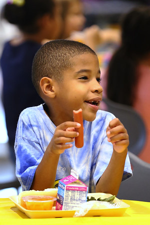 JAY YOUNG | THE GOSHEN NEWS<br /> Six-year-old Joshua Moreland, of Goshen, laughs as he enjoys lunch at the Goshen Boys & Girls Club Monday afternoon. The club opened Monday after a massive renovation project that added 20,000 square feet to the building. It was closed since June 2016.