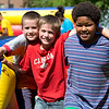 JAY YOUNG | THE GOSHEN NEWS<br /> From left, Alex Flannigan, 9, Dillon Flannigan, 9, and Jareece Gray, 11, all of Elkhart, pose for a photo during the Rhapsody in Green Music Festival at Island and Bisentennial Parks in Elkhart.