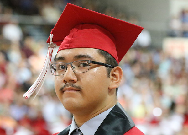 JAY YOUNG | THE GOSHEN NEWS<br /> Goshen High School graduating senior David Aguilar stands as he is recognized for academic achievement during the 2017 Commencement ceremony Sunday afternoon.