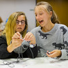 JAY YOUNG | THE GOSHEN NEWS<br /> Susan Houghton, 13, right, helps Abbey Kramer, 11, both of Goshen, tie a paracord bracelet Wednesday afternoon at the Goshen Public Library. The bracelets are to be donated to Operation Gratitude where they will be distributed to members of the armed services and first responders.