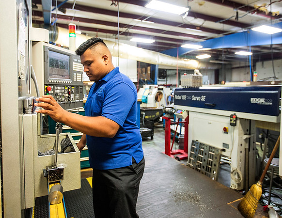 JAY YOUNG | THE GOSHEN NEWS<br /> Hector Carbajal, of Warsaw, manufactures parts for a wheel chair lift Thursday morning at Cutting Edge Machine and Tool, Inc. in New Paris. Carbajal has been with the company for the past two years and said he got his start through a vocational training school based in Warsaw.