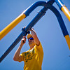 JAY YOUNG | THE GOSHEN NEWS<br /> David Teall, of Goshen, works to assemble a new swing set Thursday afternoon at Parkside Elementary School.