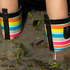 JAY YOUNG | THE GOSHEN NEWS<br /> The muddy water was no match for Taylor Martin's, 9, of Elkhart, brightly colored rainbow rain boots.