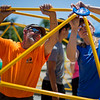 JAY YOUNG | THE GOSHEN NEWS<br /> Kevin Yoder, with the Goshen Parks and Recreation Department, and Maija Stutsman, work together in order to assemble new playground equipment Thursday afternoon at Parkside Elementary School.
