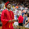 JAY YOUNG | THE GOSHEN NEWS<br /> Goshen High School graduating senior Rummel Johnson pulls on his honor cords while making his way to his chair during the 2017 commencement ceremony Sunday afternoon.