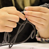 JAY YOUNG | THE GOSHEN NEWS<br /> Abbey Kramer, 11, of Goshen, works on tying a paracord bracelet Wednesday afternoon at the Goshen Public Library. The bracelets are to be donated to Operation Gratitude where they will be distributed to members of the armed services and first responders.