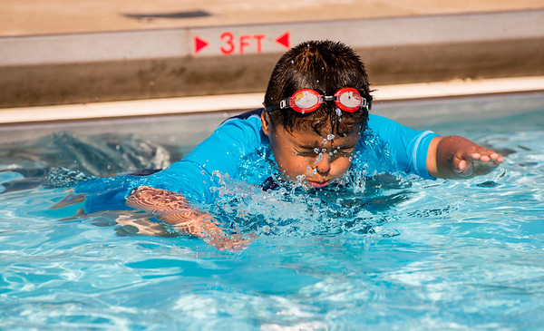 JAY YOUNG   THE GOSHEN NEWS<br /> Six-year-old Francisco Sanchez, of Ligonier, holds his breath as he pushes off from the side of the pool on the first day of Goshen Parks and Recreation department swimming classes at Shanklin Pool Monday morning. The classes run for two weeks, Monday through Friday, beginning at 9:30 a.m. Those interested should contact the parks and recreation department.