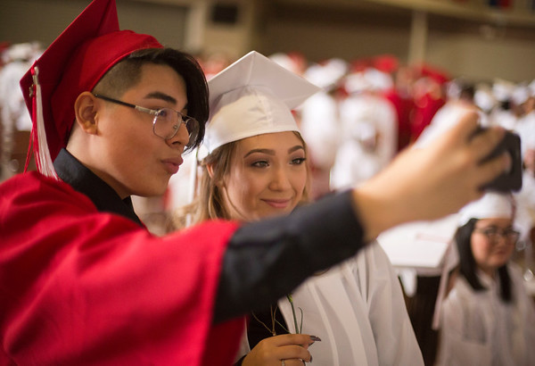 JAY YOUNG   THE GOSHEN NEWS<br /> Goshen High School graduating seniors Nathan Mayorga-Galeano and Anabel Campos pose for a selfie together during the 2017 commencement ceremony Sunday afternoon.