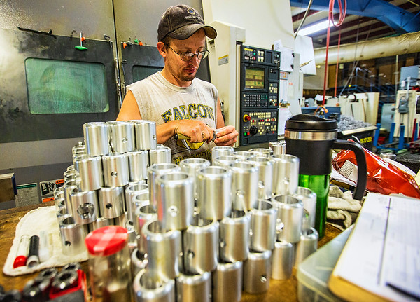 JAY YOUNG | THE GOSHEN NEWS<br /> Sam Green, of New Paris, works on creating parts for a wheel chair lift Thursday morning at Cutting Edge Machine and Tool, Inc. Green has been with the company for 12 years.