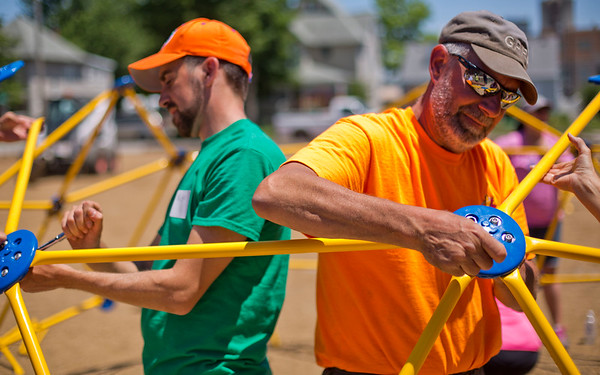 JAY YOUNG | THE GOSHEN NEWS<br /> Kevin Yoder, with the Goshen Parks and Recreation Department, right, and Austin Francis, Kalamazoo, Michigan, tighten bolts as they assemble new playground equipment Thursday afternoon at Parkside Elementary School.