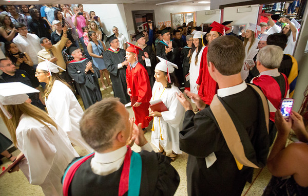 JAY YOUNG   THE GOSHEN NEWS<br /> Goshen High School graduates make their way out of the gymnasium as friends and families cheer them on during the 2017 commencement ceremony Sunday afternoon.