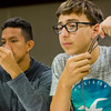 JAY YOUNG | THE GOSHEN NEWS<br /> Isaiah Dilworth, 14, right, and Rodrigo Lazo, 15, hold up paracord as they watch a video to learn how to tie paracord bracelets Wednesday afternoon at the Goshen Public Library. The bracelets are to be donated to Operation Gratitude where they will be distributed to members of the armed services and first responders.
