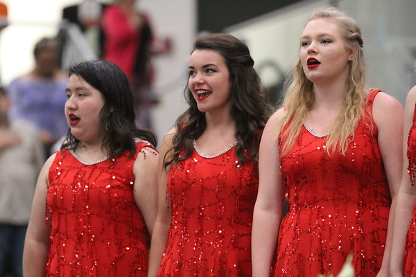 "ADAM RANDALL | THE GOSHEN NEWS<br /> Nia Cervantes, Zoe White and Sarah Weaver, Wawasee's ""Vocal Motion"" singers, lead the National Anthem"