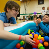 JAY YOUNG | THE GOSHEN NEWS<br /> Northridge Middle School eighth-grade student Sydney Eash plays with Elvis Arellano in a pool full of colorful plastic balls during Ability Day at the school.