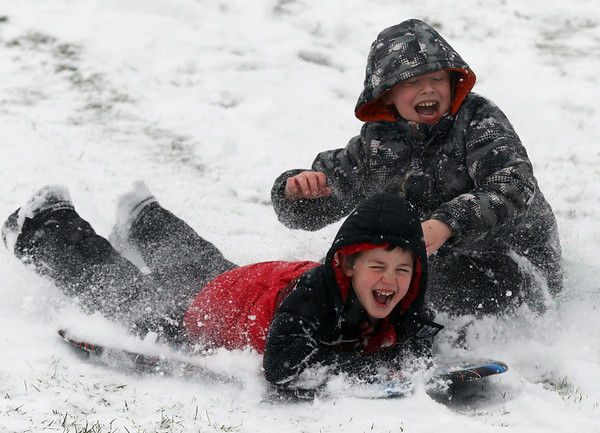 JAY YOUNG | THE GOSHEN NEWS<br /> Snow flies as seven-year-old Reese Weirick, front, and brother Pryce, 10, both of Goshen, race down the sledding hill at Abshire Park on Monday afternoon. Winter returned to the Goshen area in a big way on Monday, with below freezing temperatures and several inches of snow. The National Weather Service forecasts the cold temperatures to remain in place over the next few days.
