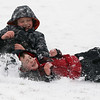JAY YOUNG | THE GOSHEN NEWS<br /> Seven-year-old Reese Weirick, front, and brother Pryce, 10, both of Goshen, tumble down the sledding hill at Abshire Park on Monday afternoon. Winter returned to the Goshen area in a big way on Monday, with below freezing temperatures and several inches of snow. The National Weather Service forecasts the cold temperatures to remain in place over the next few days.
