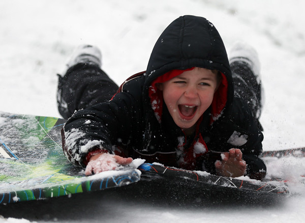 JAY YOUNG | THE GOSHEN NEWS<br /> Seven-year-old Reese Weirick, of Goshen, hangs on tight to two sleds as he lets out a scream while racing down the sledding hill at Abshire Park on Monday afternoon. Winter returned to the Goshen area in a big way on Monday, with below freezing temperatures and several inches of snow. The National Weather Service forecasts the cold temperatures to remain in place over the next few days.