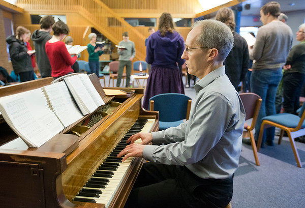 JAY YOUNG | THE GOSHEN NEWS<br /> Brian Wiebe, of Goshen, plays the piano while participating in the Sing for Peace Hymn Marathon, hosted by Goshen College's Hymn Club, Tuesday evening in room 19 of the Newcomer Center at the college. The club is singing through Hymnal: A Worship Book in order to raise funds for Christian Peacemaker Teams. The marathon, which began on Sunday, will continue through the end of the week.