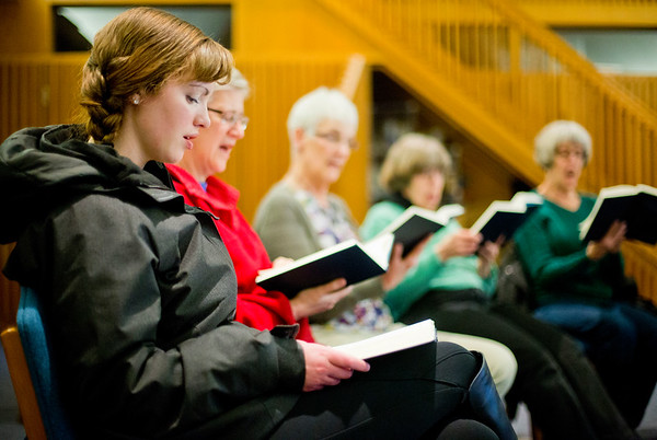 JAY YOUNG | THE GOSHEN NEWS<br /> Emily Schooley, who was visiting from Tacoma, Wash., dropped by Goshen College to take part in the Sing for Peace Hymn Marathon, hosted by the college's Hymn Club, Tuesday evening in room 19 of the Newcomer Center at the college. The club is singing through Hymnal: A Worship Book in order to raise funds for Christian Peacemaker Teams. The marathon, which began on Sunday, will continue through the end of the week.