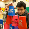 JAY YOUNG | THE GOSHEN NEWS<br /> Concord South Side third-grader Jesus Escobar-Ortiz works to stacks cups in a pyramid along with Northridge Middle School eighth-grader Carter Stoltzfus during Ability Day at the school.