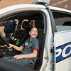 JAY YOUNG | THE GOSHEN NEWS<br /> Twelve-year-old Erik Miller flashes a huge smile as he gets to sit inside a Goshen police cruiser during the Champions Together carnival at Goshen High School on Friday night.
