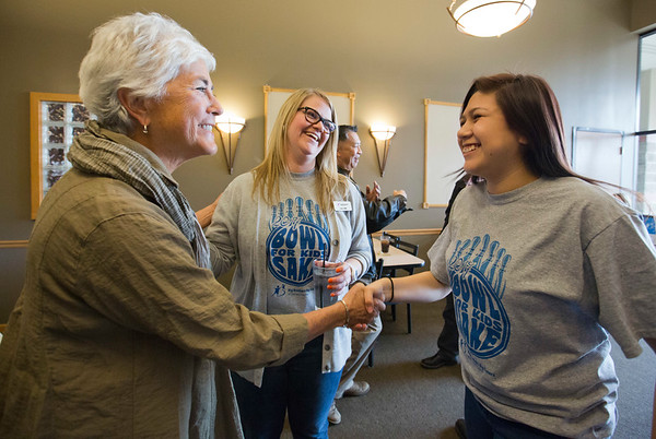 JAY YOUNG | THE GOSHEN NEWS<br /> Phid Wells, left, shakes hands with Tori Gamez while Samantha Crooks watches during the Big Sister of the year open house in Elkhart.