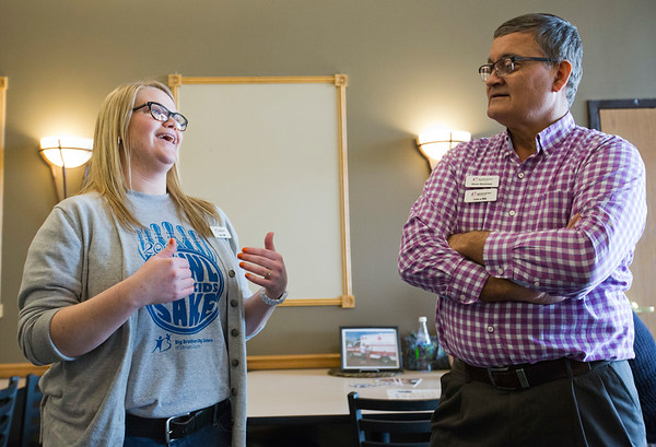 JAY YOUNG | THE GOSHEN NEWS<br /> Samantha Crooks shares a laugh with Glenn Stutzman during the Big Sister of the year open house in Elkhart.