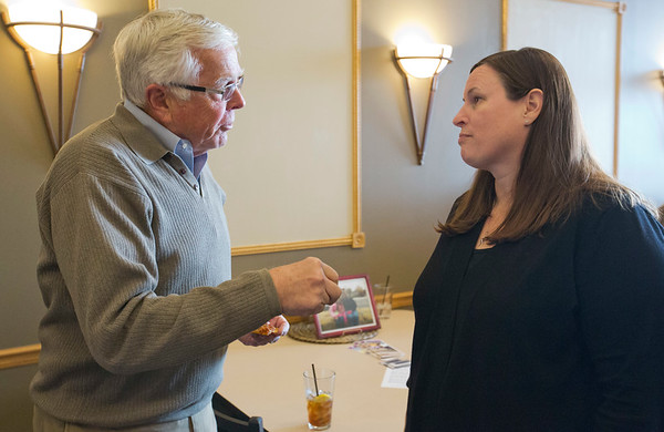 JAY YOUNG | THE GOSHEN NEWS<br /> Jeff Wells and Amanda Jamison chat during the Big Sister of the year open house Thursday evening in Elkhart.