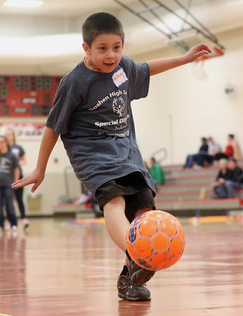 JAY YOUNG | THE GOSHEN NEWS<br /> Eight-year-old Anthony Taylor, of Goshen, scores a goal during the Champions Together carnival at Goshen High School on Friday night.