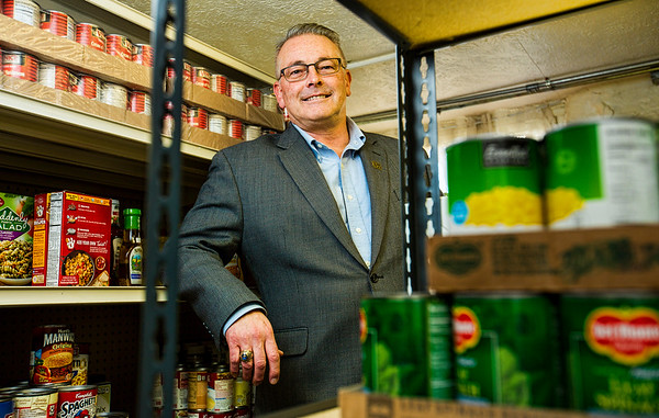 JAY YOUNG | THE GOSHEN NEWS<br /> Mark Mikel, executive director of the Family Christian Development Center is photographed in the basement storage area of the center's food pantry Tuesday, March 21, 2017.