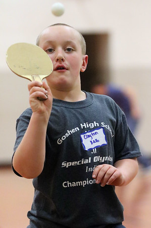JAY YOUNG | THE GOSHEN NEWS<br /> Clayton Kalb lines up his paddle with the ping pong ball as he plays a game of table tennis during the Champions Together carnival at Goshen High School on Friday night.