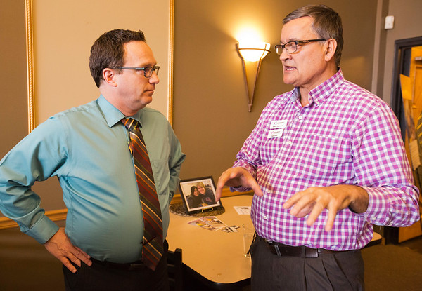 JAY YOUNG | THE GOSHEN NEWS<br /> Glenn Stutzman, left, and Chris Hooley have a chat  during the Big Sister of the year open house Thursday evening in Elkhart.