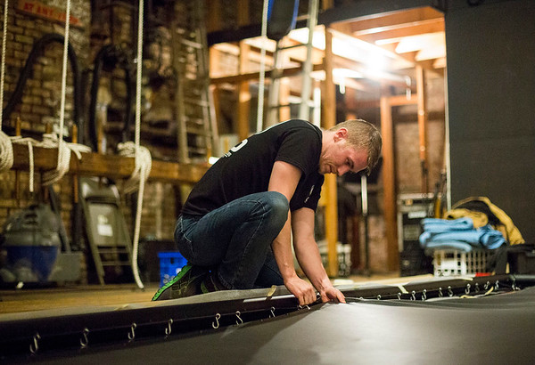 JAY YOUNG | THE GOSHEN NEWS<br /> Brent Rucker fastens a movie screen to its frame as he works to install the screen inside of the Goshen Theater on Tuesday afternoon in preparation for the upcoming River Bend Film Festival.