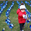 SHERRY VAN ARSDALL | THE GOSHEN NEWS<br /> Nineteen-month-old Drake Allen looks at one of 3,000 pinwheels around the lawn in front of the Child and Parent Services building in Elkhart Friday afternoon. April is National Child Abuse Prevention Awareness Month and the pinwheels represent 3,000 babies born in Elkhart County each year.