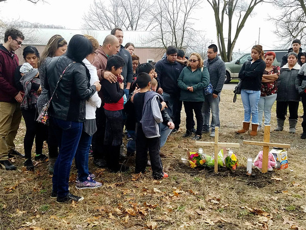 CONTRIBUTED BY DELIA VASQUEZ<br /> Family and community members hold a vigil Sunday afternoon for Susana Alvarez and Alberto Avelino in the vacant lot along Edgewood Drive where their bodies were found Saturday in a van.
