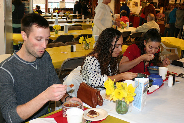 SHEILA SELMAN | THE GOSHEN NEWS<br /> Enjoying some soup at the Empty Bowl Project Saturday are, from left, Alex McIntyre of South Bend, Ashley Fehlberg of Goshen and Jessica Camacho-Chavez of Goshen.