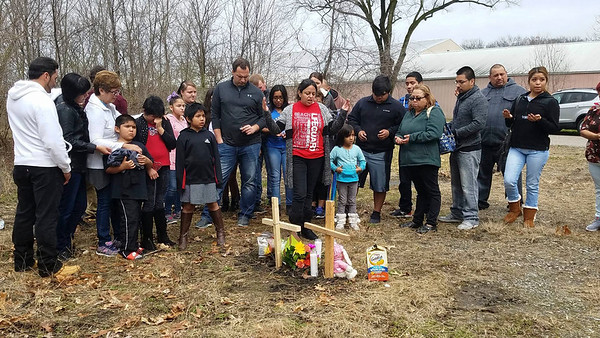 PHOTO CONTRIBUTED BY DELIA VASQUEZ<br /> Prayers are said Sunday afternoon for the Elkhart couple found dead in a van parked at a vacant lot along Edgewood Street in Elkhart Saturday. The victims have been identified as Susana Alvarez and Alberto Avelino.
