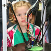 SHERRY VAN ARSDALL | THE GOSHEN NEWS Kensie Johnson, 5, New Paris, watches a 3D printer during the Midwest RepRap Festival at the Elkhart County Fairgrounds Saturday.