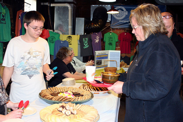 SHEILA SELMAN | THE GOSHEN NEWS<br /> Dawn Rodman, right, decides on a dessert at the Empty Bowl Project fundraiser Saturday at the Goshen Farmers Market.