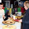 SHEILA SELMAN | THE GOSHEN NEWS<br /> Dawn Rodman, right, decides on a dessert at the Empty Bowl Project fundraiser Saturday at the Goshen Farmers Market.