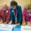 JAY YOUNG | THE GOSHEN NEWS<br /> From left, Tony England, representing Elkhart Community Schools, Karen Blaha, with Goshen Community Schools and Stacy Bowers, with Goshen Health, ceremoniously sign contracts with Triple P on Monday afternoon at River of Life Community Church. Triple P, which stands for Positive Parenting Program, is a program that teaches parenting strategies.